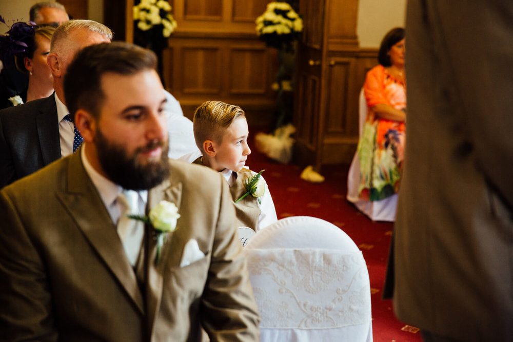 page boy looking at wedding ceremony