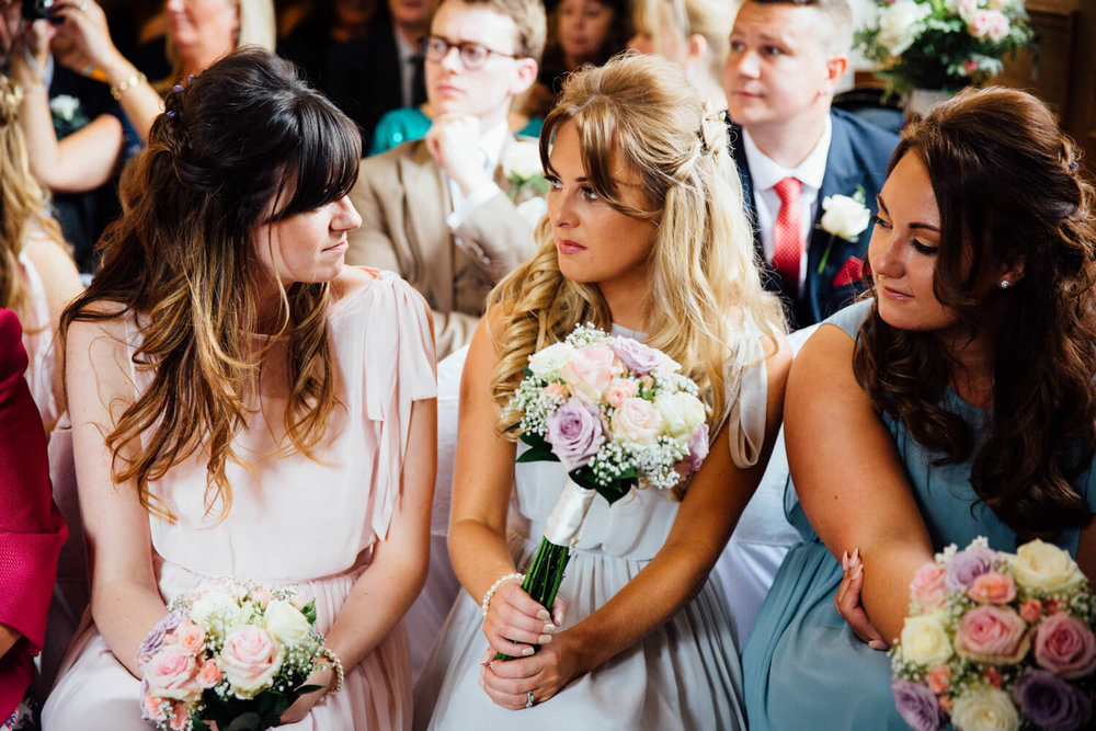bridesmaids holding flowers and chatting