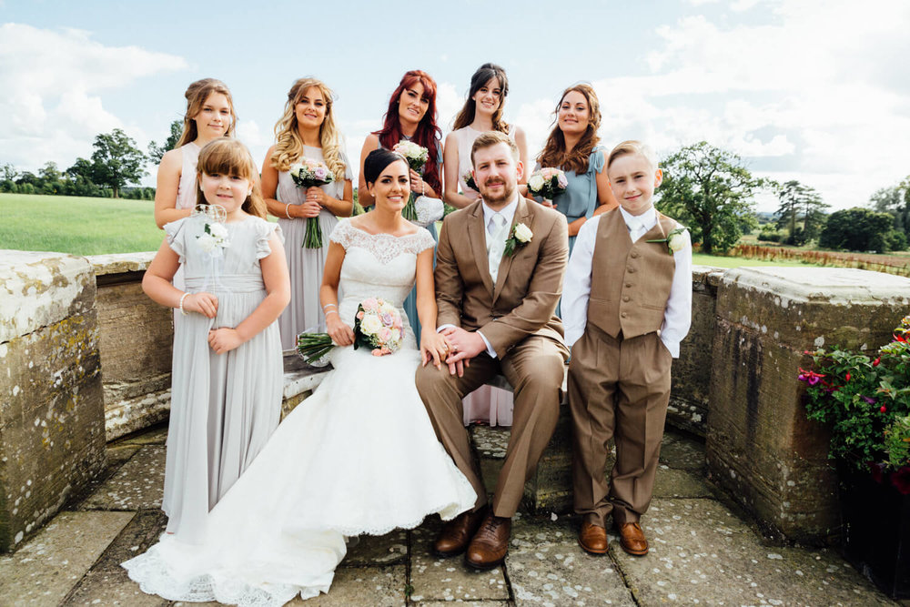 bridal party in breathtaking grounds with Welsh mountains