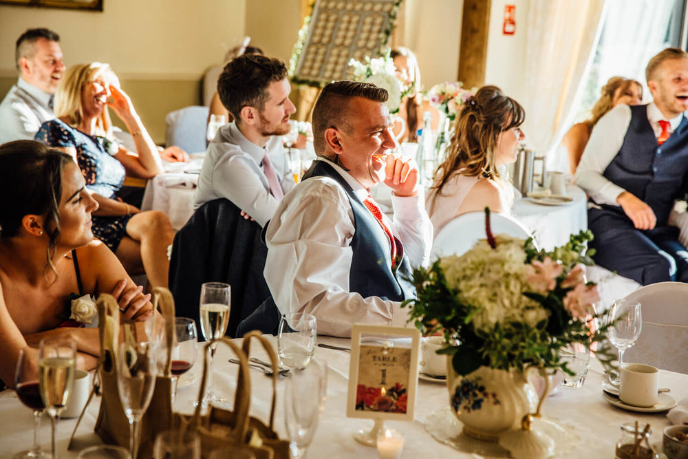 wedding guest laughing at speech