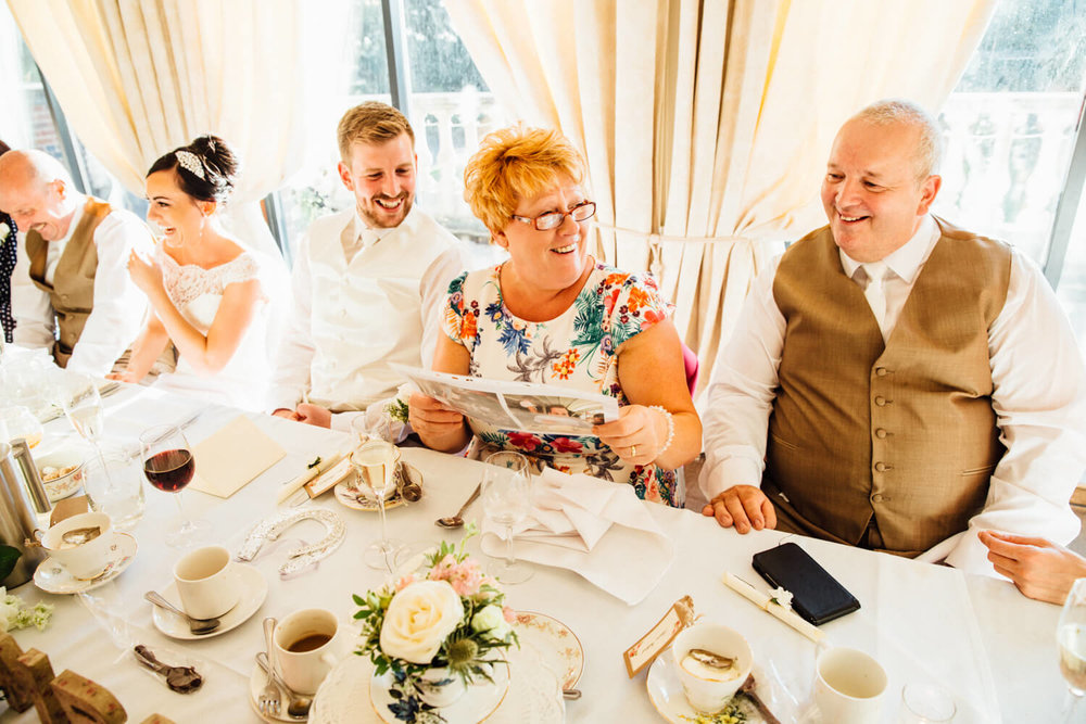 mother of bride laughing at groom