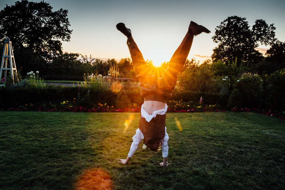 handstand sunset photograph of pageboy