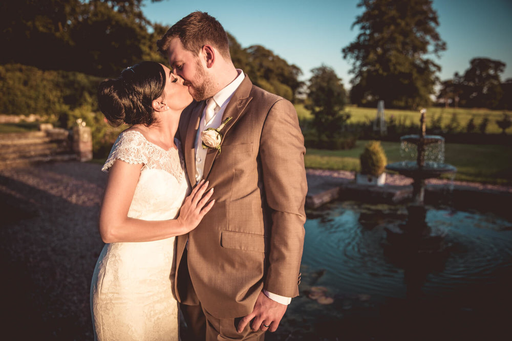 second kiss of newlyweds in gardens