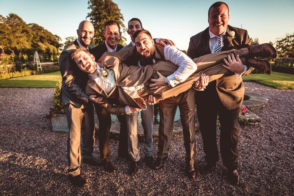 groomsmen having a joke
