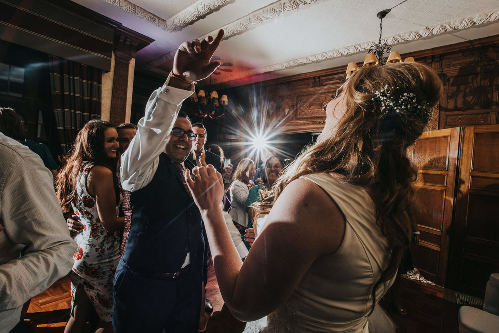 bride-groom-dancing-celebrating-on-dancefloor.jpg