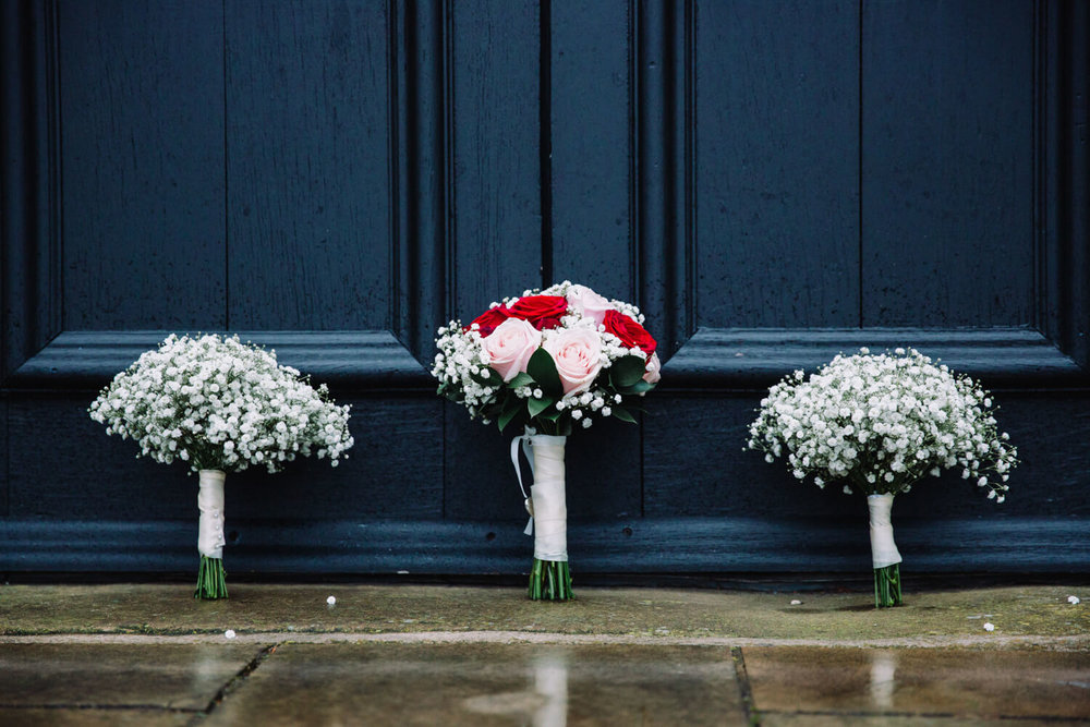 wedding bouquets in doorway