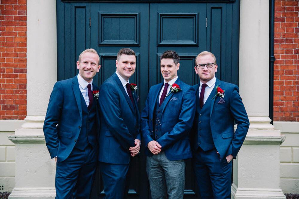group groomsmen portrait in doorway
