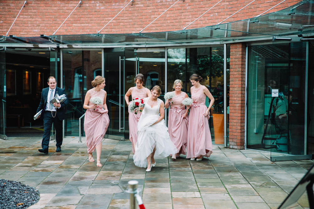 Bride and bridesmaids making way to ceremony