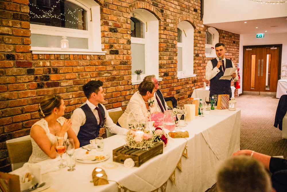 Best man giving funny speech to Groom