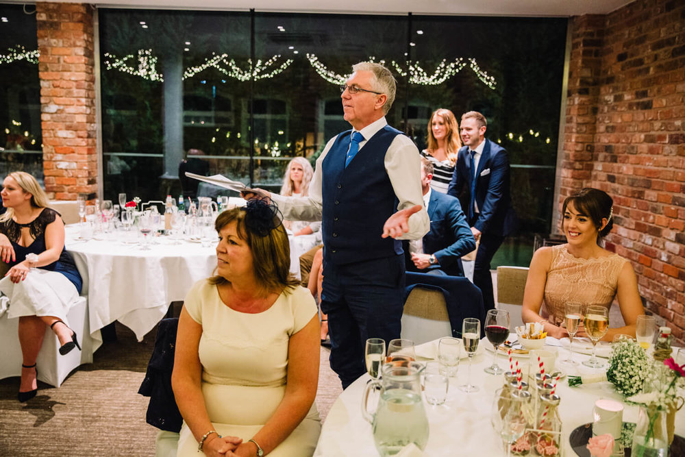 Guest stood up during speech asking questions to Groom