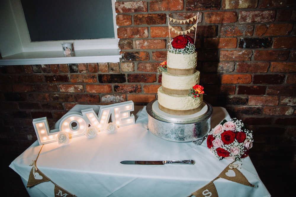 Wedding cake table with light up LOVE lettering