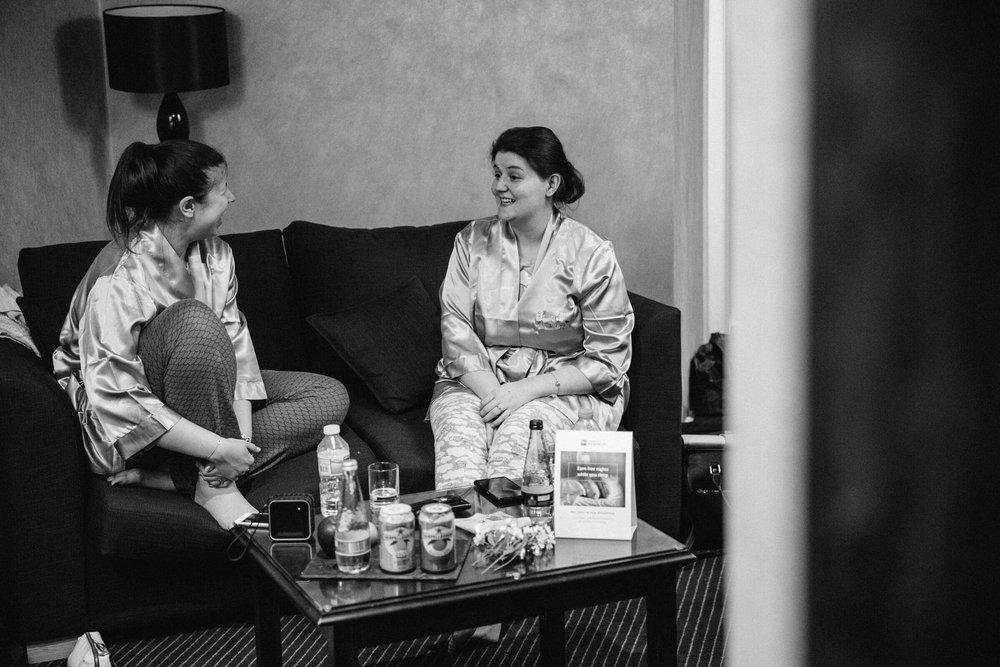 Bridesmaids chatting on sofa