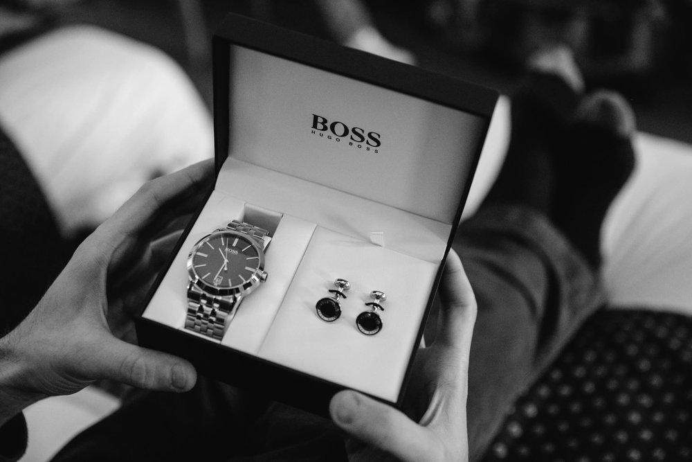 Groom receiving boss watch gift