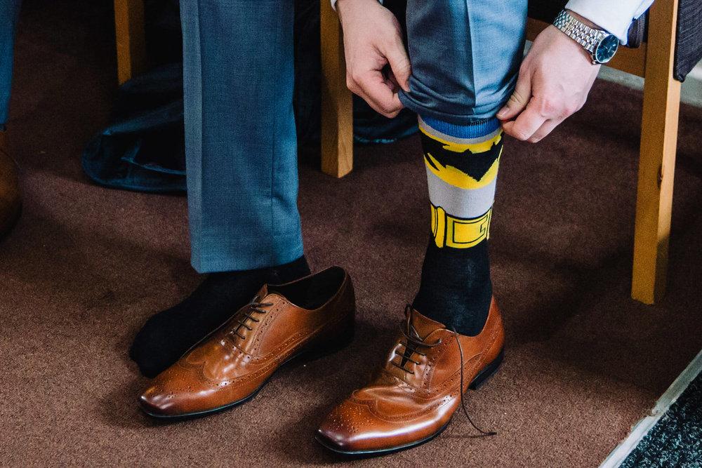 superhero socks being put on