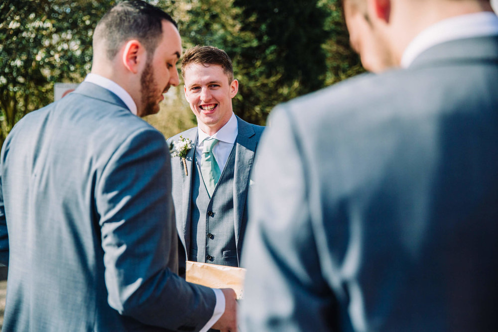 groomsmen outside laughing