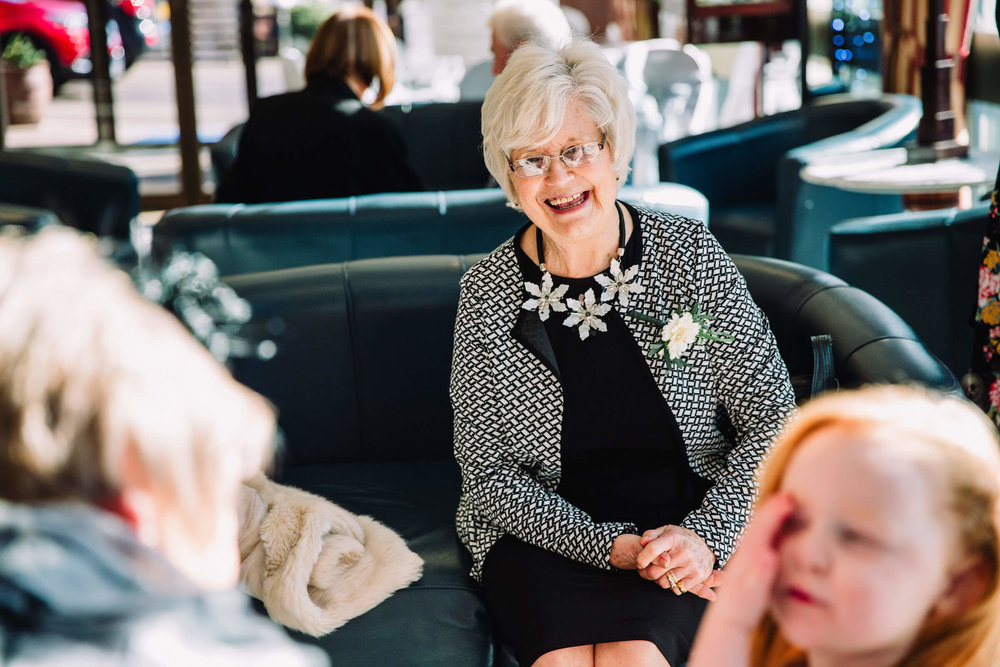 laughing grandma awaiting the ceremony