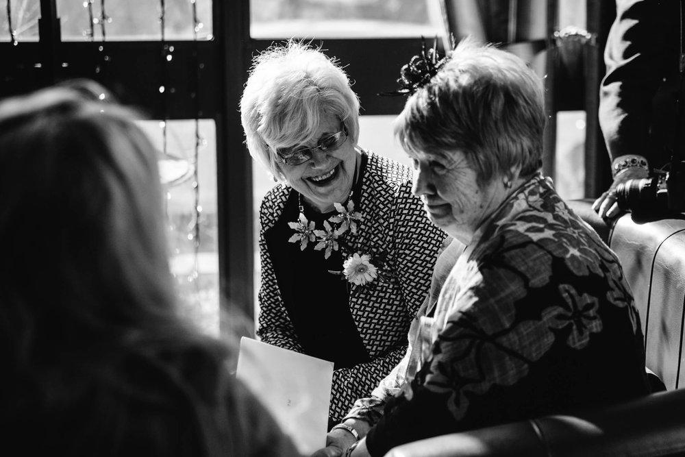 grandma laughing at guests