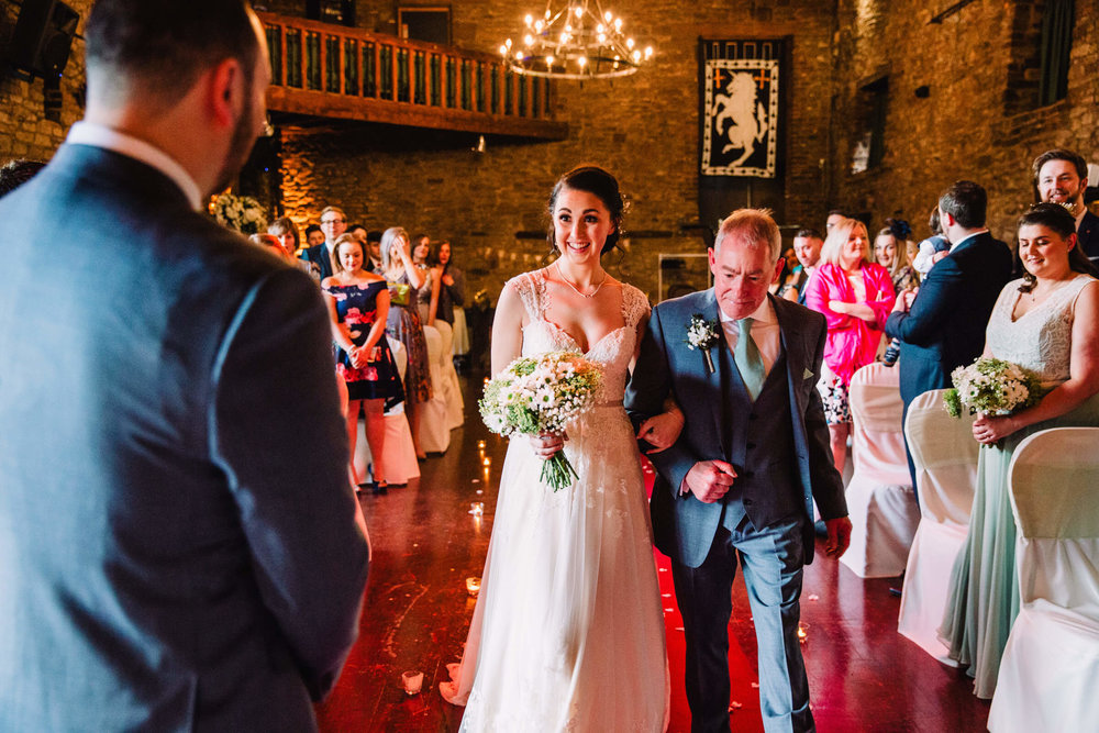 bride first look to groom in medieval banqueting room