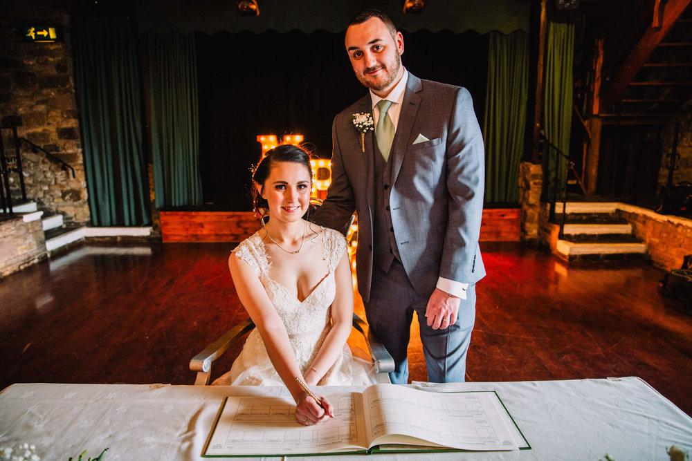 Newlyweds signing of wedding register