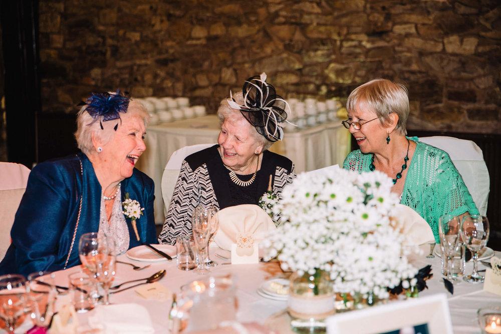 grandmas laughing and joking at breakfast table