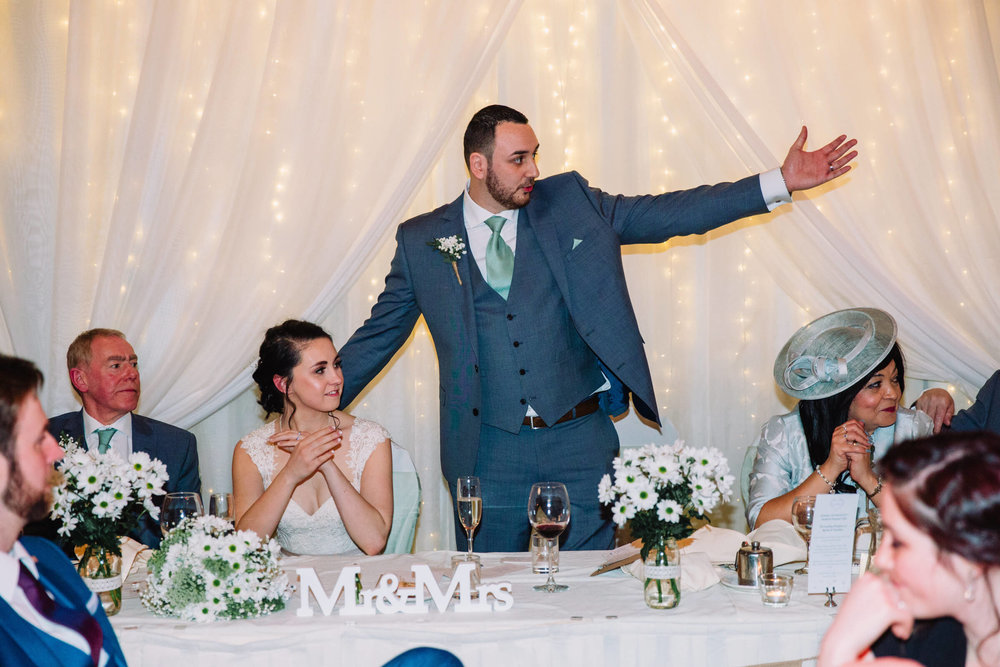 groom giving speech to family
