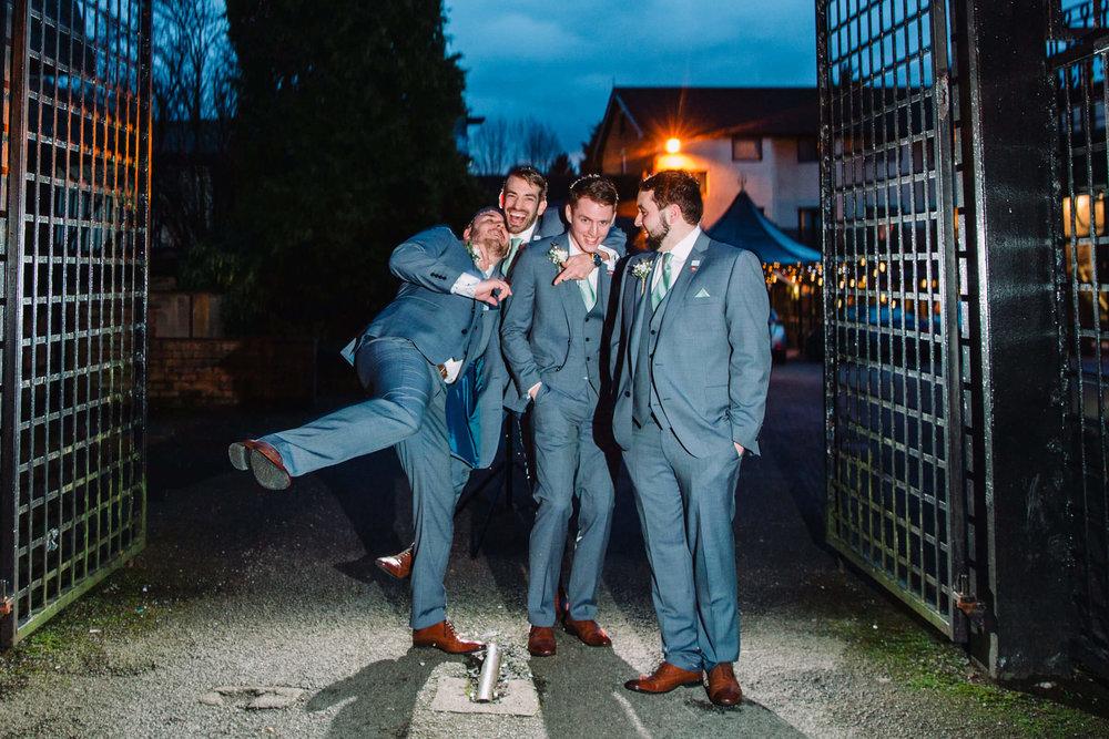 groomsmen portrait at night