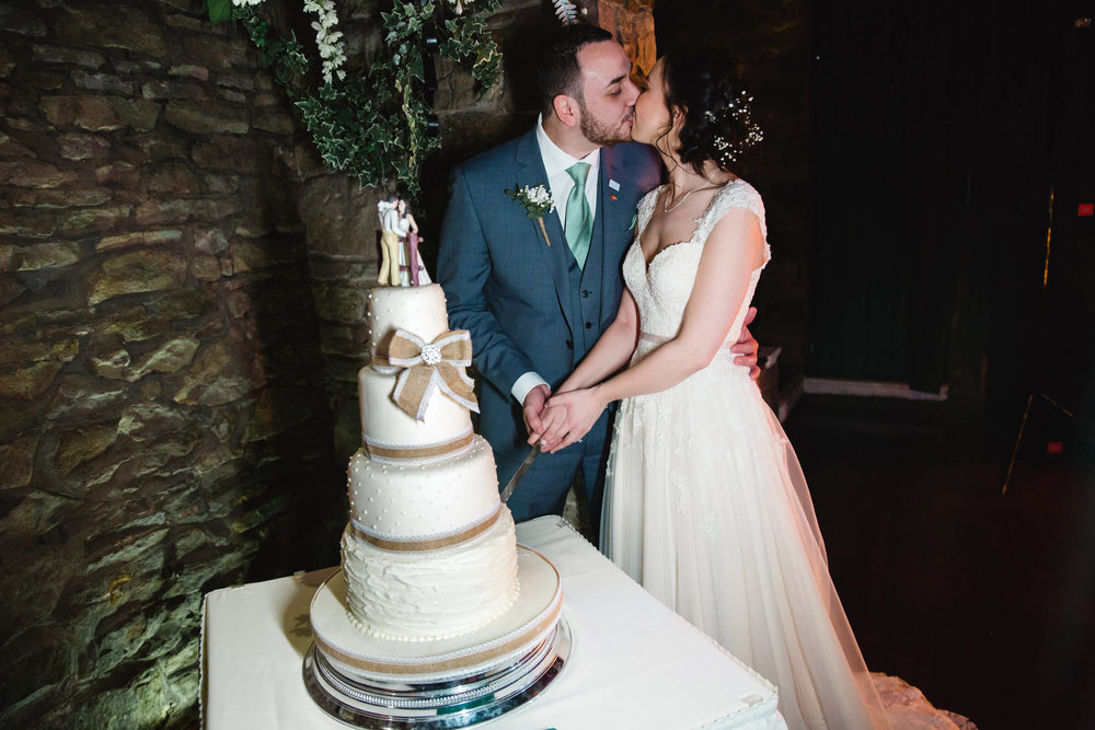 cutting of the wedding cake and a kiss