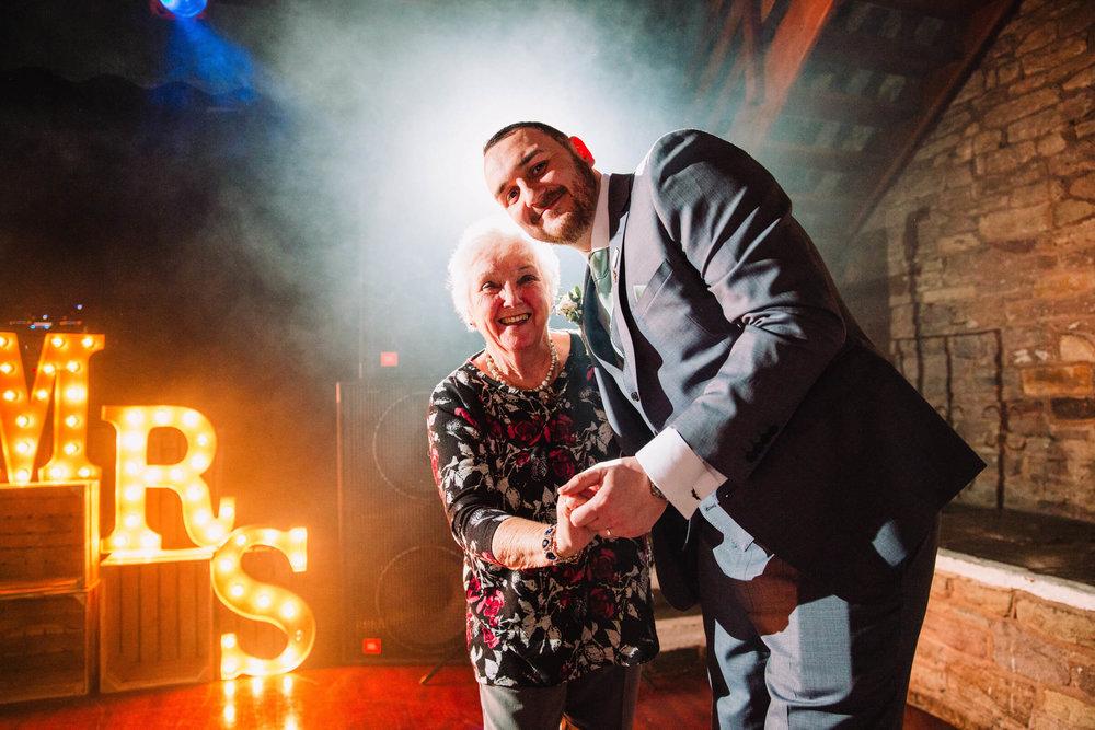 groom with grandma on dancefloor