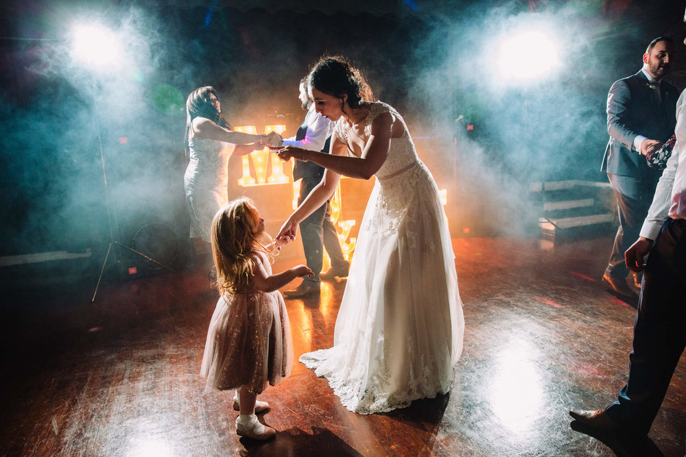 bride with flower girl on the dance floor