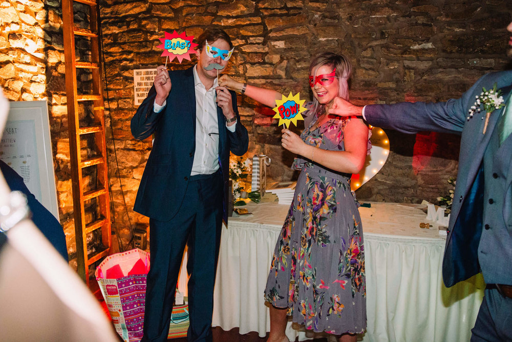 superhero photo booth with wedding guests