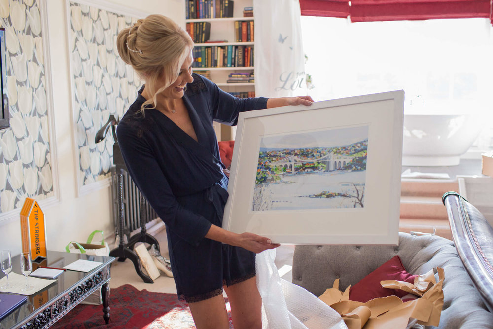 Bride loves the painting of the Menai bridge as a present from Groom