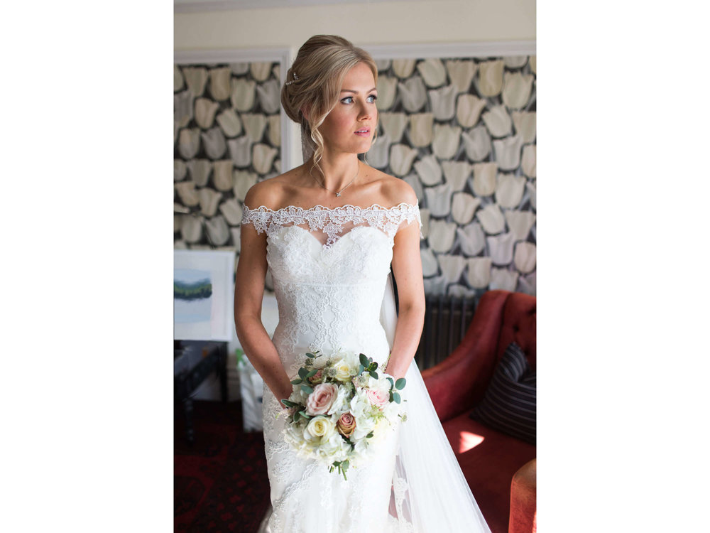 bridal portrait of wedding dress and bouquet