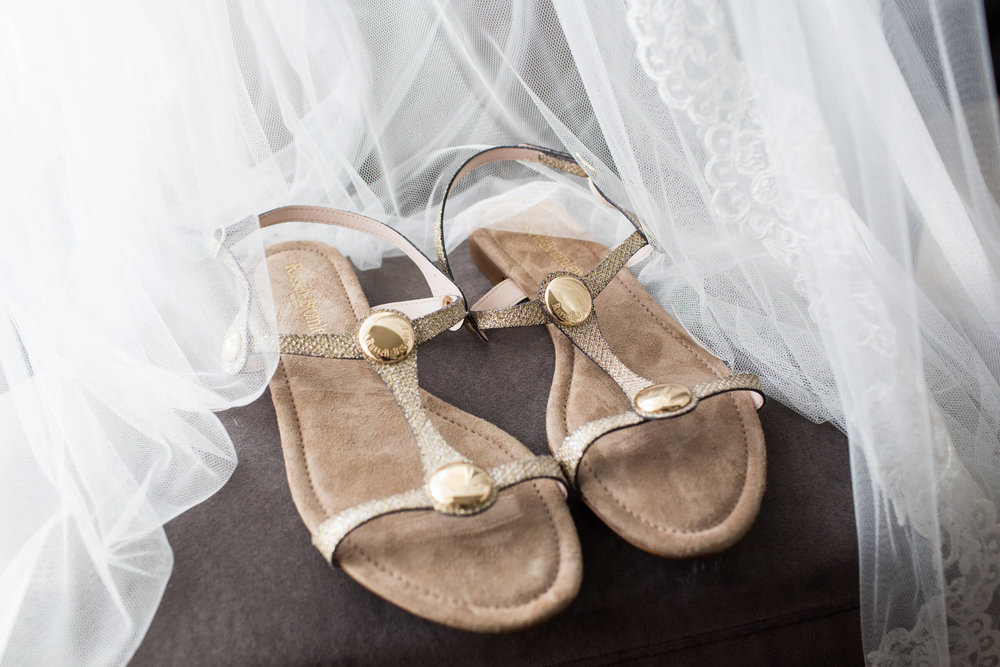 wedding shoes and veil on chair