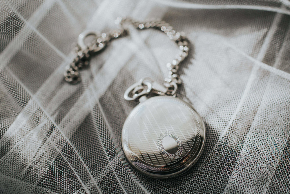 close up of wedding gift for groom, a pocket watch
