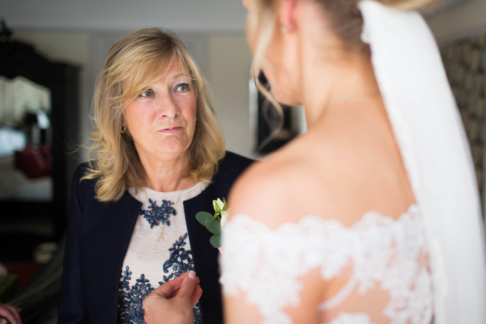 mother of bride looking on to daughter