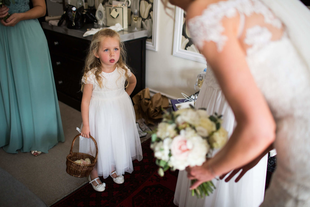 flower-girl with basket of petals ready for ceremony