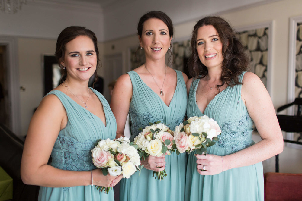 portrait of bridesmaids holding bouquets