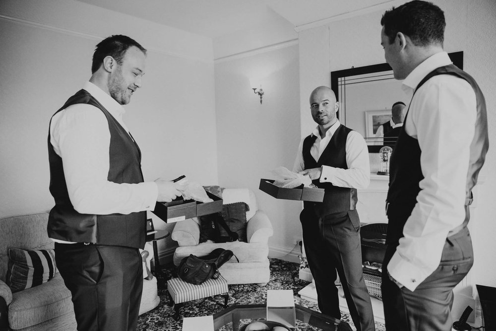 groom and ushers getting ready in the morning