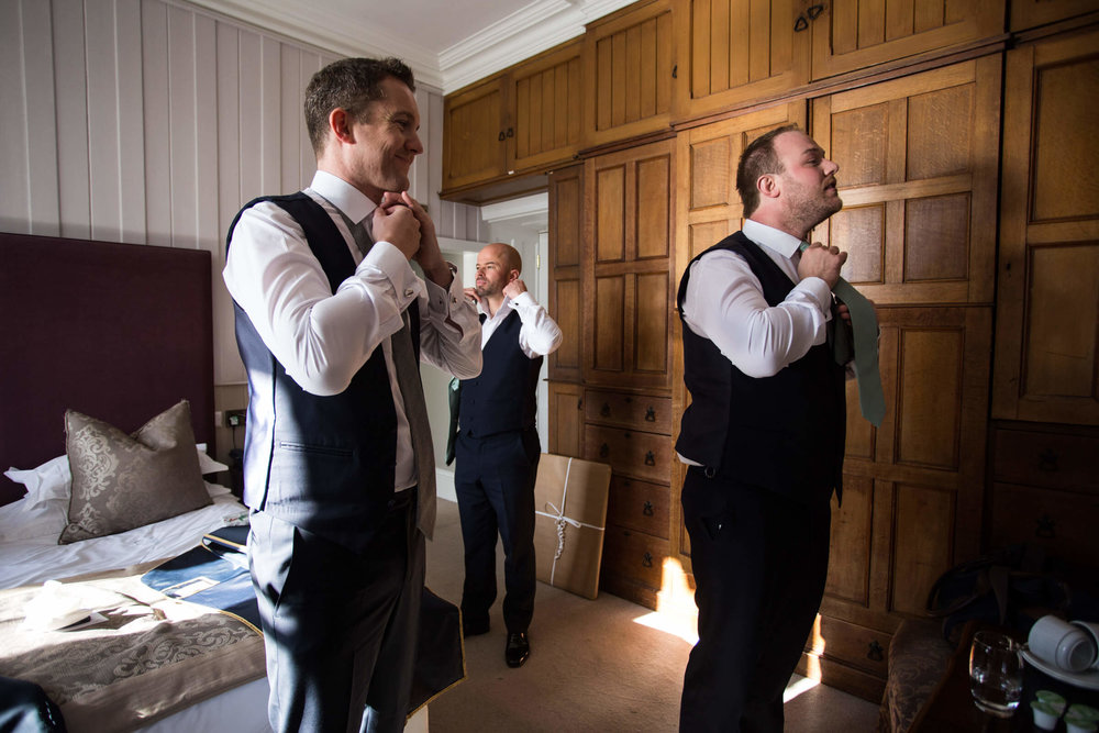 Groomsmen getting ready in their room