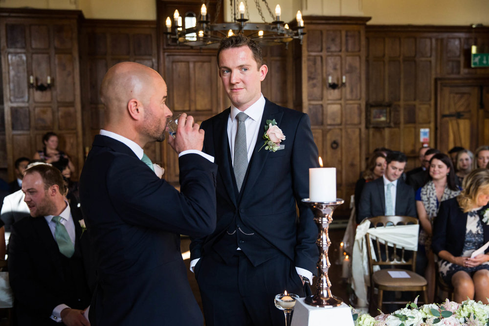groom and usher waiting for bride in the banqueting hall
