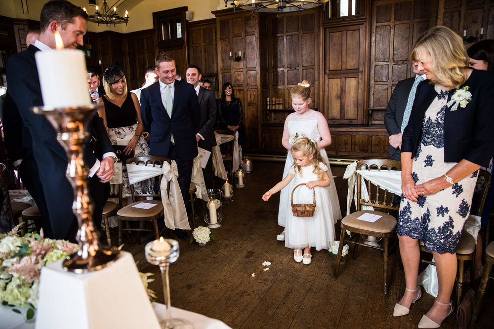 flower-girl dropping petals on aisle for wedding