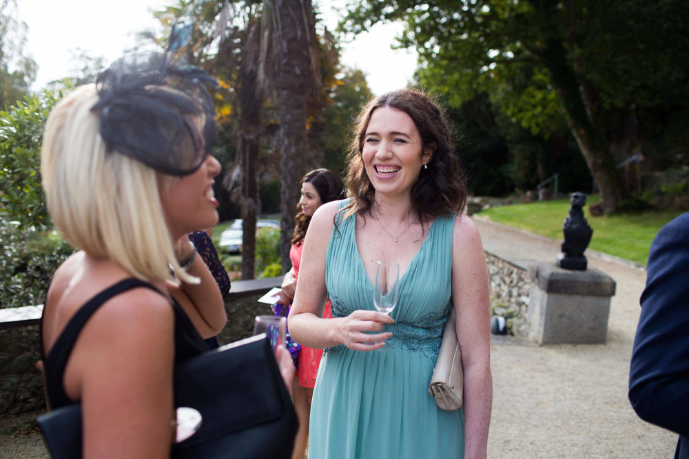 bridesmaid laughing with guest