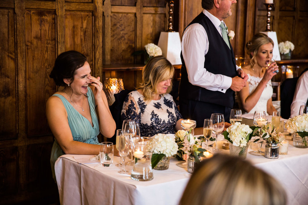 bridesmaid laughing out loud at speeches