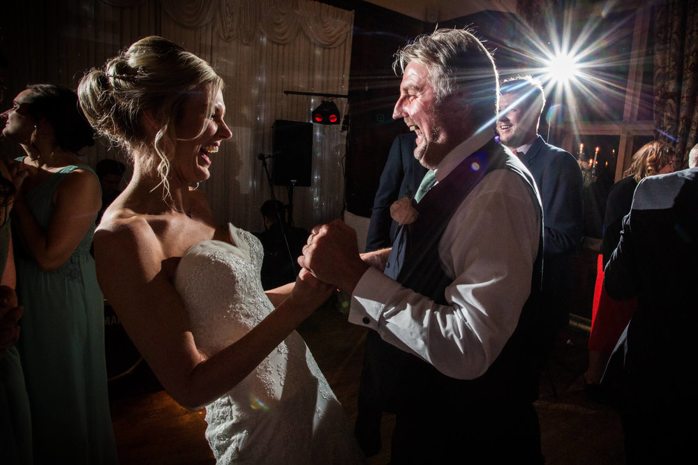 bride and father sharing a laugh and a dance during first dance at wedding