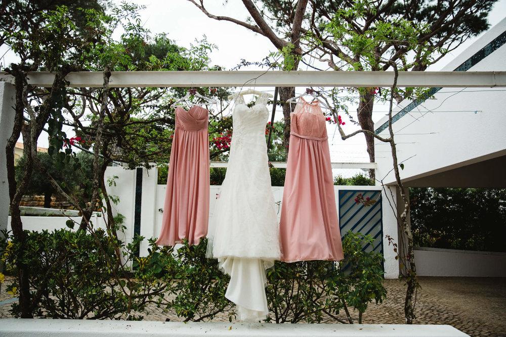 wedding dress and bridesmaid dresses hung up
