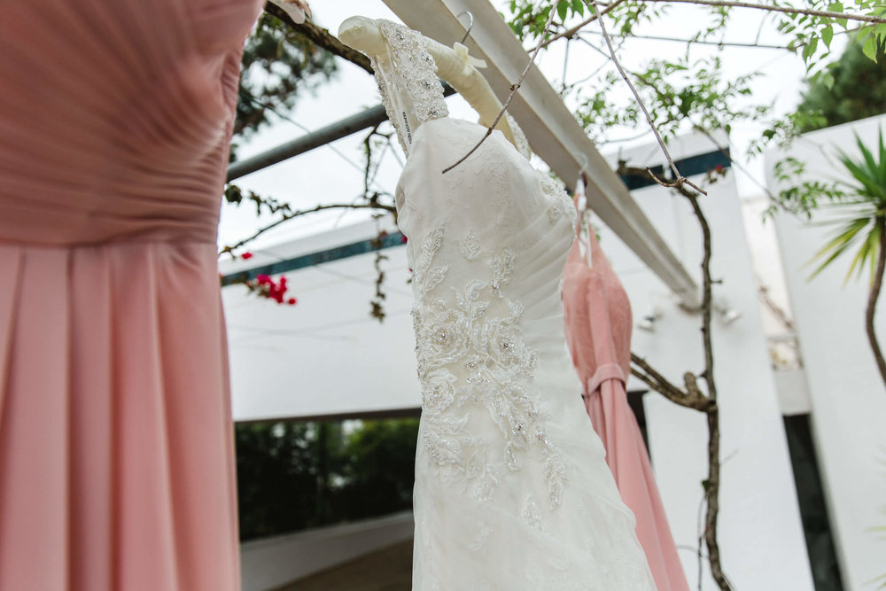 close up of wedding dress on rail