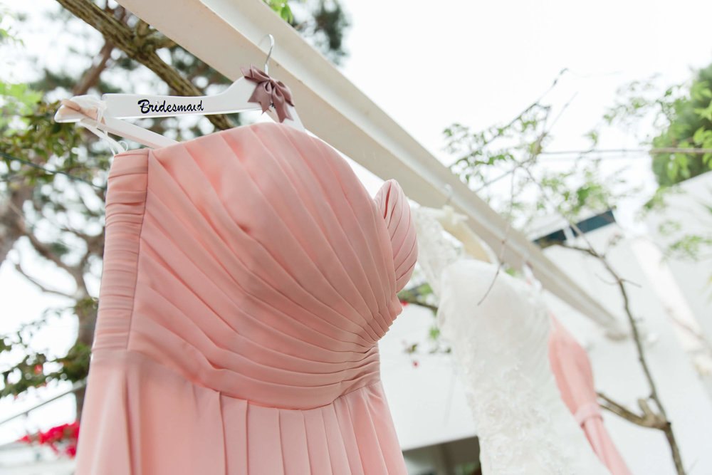 detail photograph of bridesmaid dress outside villa