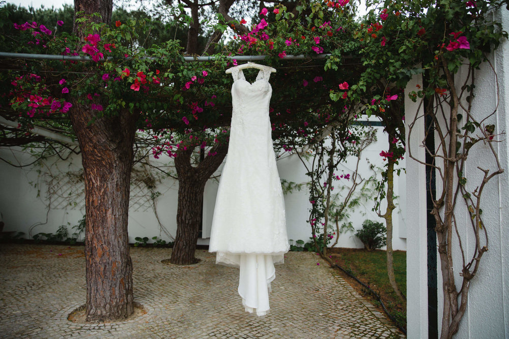 front view of wedding dress hung on tree