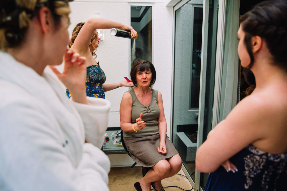 mother of bride having hair styled