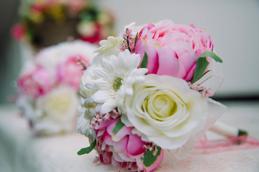 bridesmaid bouquet on white villa ledge
